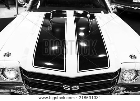 Sankt-Petersburg Russia July 21 2017: Front view of a great retro muscle car Chevrolet Camaro SS. Car exterior details. Black and white. Photo Taken on Royal Auto Show July 21