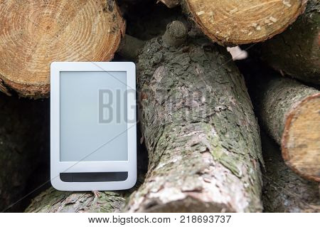 E-book on the background of felled trees save trees - read ebooks