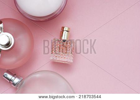 Perfume bottles pink background. Perfumery, cosmetics fragrance
