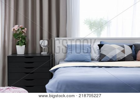 Modern bedroom interior with comfortable bed
