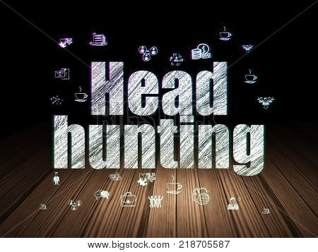 Business concept: Glowing text Head Hunting,  Hand Drawn Business Icons in grunge dark room with Wooden Floor, black background