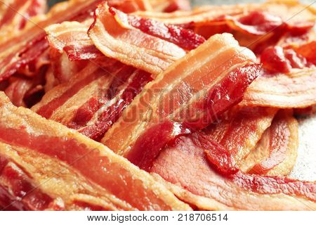 Cooked bacon rashers, closeup