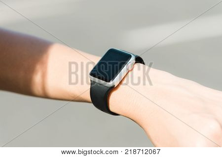 Woman using smartwatch with e-mail notifier. smartwatch hand device notify computer internet message e-mail concept. Woman hand with smartwatch. Technology concepts