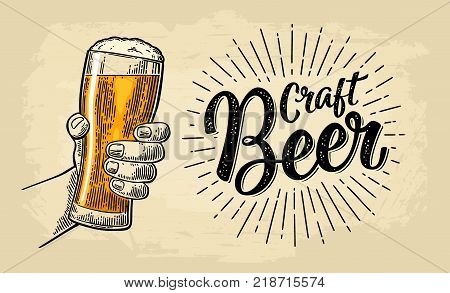 Male hand holding a beer glass. Craft Beer calligraphic lettering with ray. Vintage color vector engraving illustration for web, poster, invitation to party or festival. Isolated on beige background