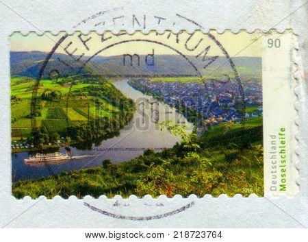 GOMEL, BELARUS, 15 DECEMBER 2017, Stamp printed in Germany shows image of The Moselle is a river flowing through France, Luxembourg, and Germany, circa 2017.