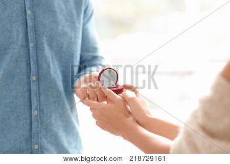 Man proposing to his beloved with beautiful engagement ring, closeup
