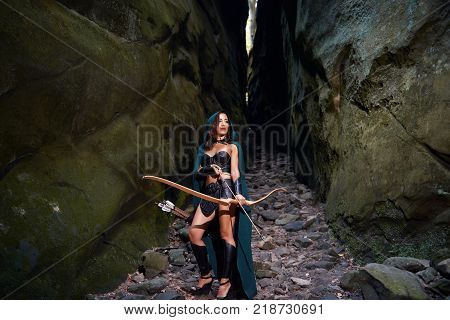 Full length shot of a female warrior with a bow and arrows wandering through the woods copyspace archer archery fighter Amazon tribal traditional feminism power confidence skilled.