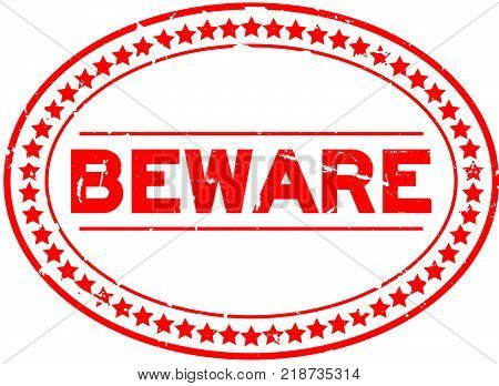 Grunge red beware word oval rubber seal stamp on white background