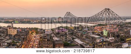 Kolkata, India - April 13, 2017: Beautiful panorama of Kolkata city with a Howrah bridge on the river Hooghly during sunset.