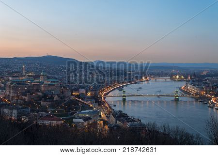Historic Royal Palace - Buda Castle on night in light the background Chain Bridge in Budapest Hungary