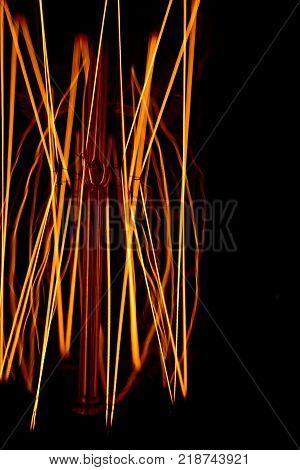 Abstract incandescent filament light bulb close up