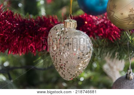 Paper Scroll, Wishlist Rolled Up On Christmas Tree. Beautiful Close Up Holiday Photo.