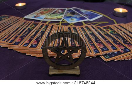 Card Tarot reader. Magic. Miracles. Divination by candlelight.