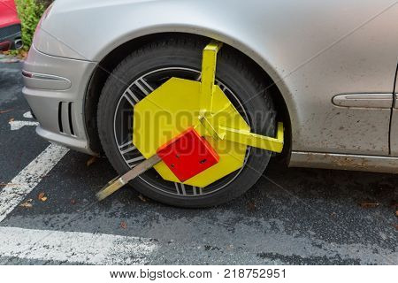 Karlovy Vary, Czech Republic - October 30, 2017: Car was locked with clamped vehicle wheel lock.