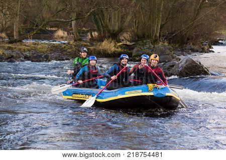 Llangollen Wales UK - January 28 2017: White water rafting on the river Dee or Afon Dyfrdwy in North Wales
