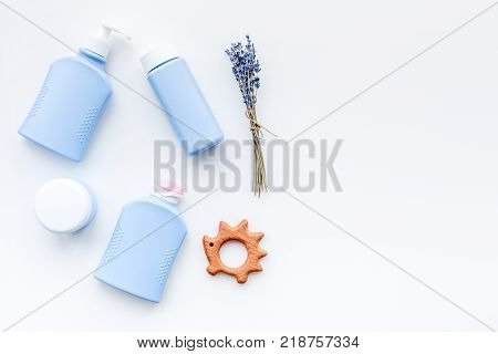 Natural bath cosmetics for kids. Bottles and toys on white background top view.