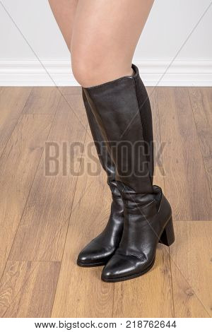 Woman Modelling Black Knee High Leather Boots