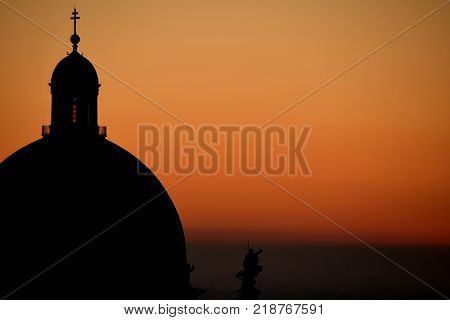 The dome of Brescia Cathedral in backlight at sunset - Brescia - Lombardy - Italy poster