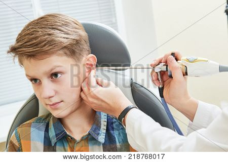 Ear, nose, throat examining. ENT doctor with a child patient and endoscope