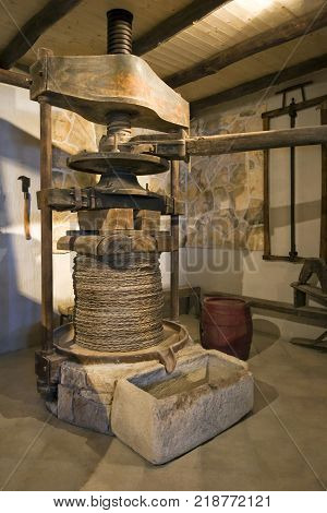 Ancient olive oil production machinery mechanical manual press and stone oil container on Island Korcula in Croatia