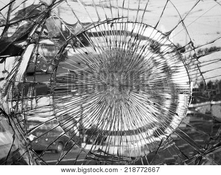Broken mirror glass in which is reflected the city. Monochrome variant. Dark colors give a gloomy, mournful mood and mystery. Suitable for the illustration of the Apocalypse, destruction, crash.