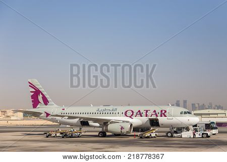 DOHA QATAR - October 05 2013: Airbus A320 of Qatar Airways. Plane during preparation for departure.