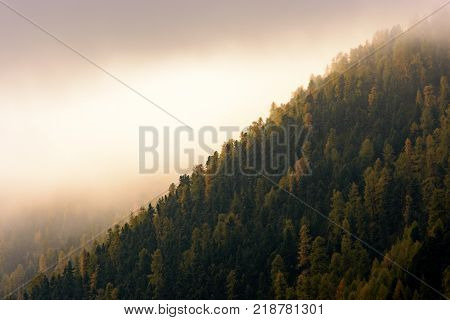 Sunrise over mountains and lake with canoeist