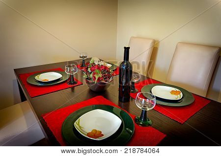 wine and plates on wooden kitchen table