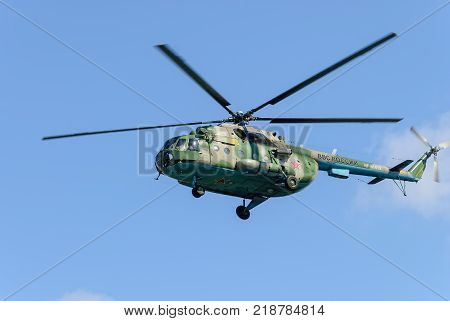 Tyumen, Russia - August 4, 2017: International Army Games. Engineering Formula contest. Military helicopter MI-8 in the cloudy sky