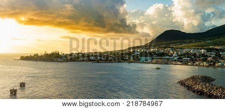 panorama of Basseterre, St Kitts, and harbor at sunset.