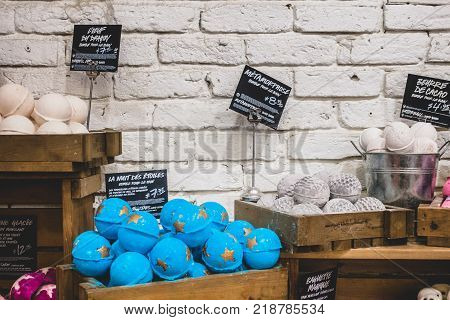 Inside Lush Shop In Montreal On St-denis Street. Wide Shot Of The Wall And Display Of Different Soap