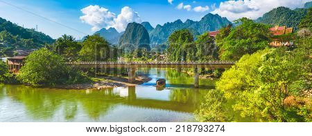 Amazing landscape of Nam Song river among mountains. Bridge on the foreground. Pha Tang, Vang Vieng district, Laos. Panorama