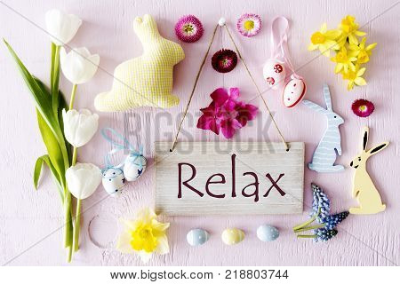 Wooden Sign With English Text Relax. Easter Flat Lay With Decoration Like Easter Bunny And Easter Egg. Spring Flower Blossoms Like Tulipa, Daisy And Narcissus.