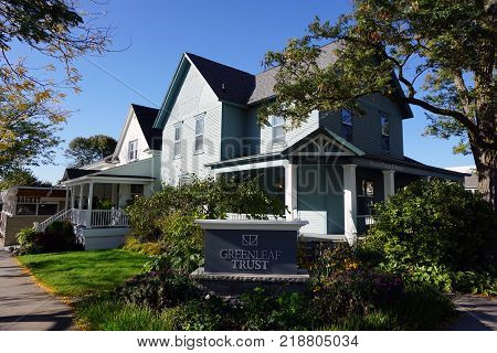 PETOSKEY, MICHIGAN / UNITED STATES - OCTOBER 18, 2017: Greenleaf Trust is a privately-held wealth management firm with specialized disciplines in asset management, trust administration and retirement plan services, on Bay Street in downtown Petoskey.