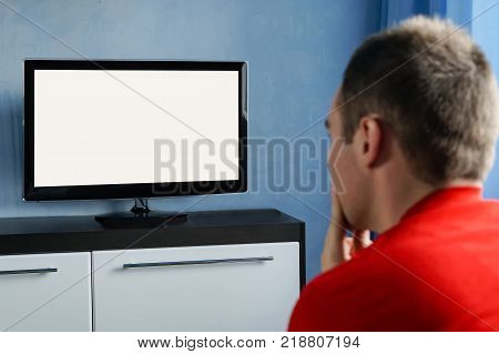 The Young Man Stares At The Tv. Blank Screen White Screen