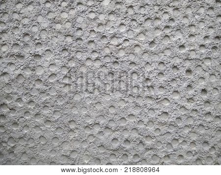 Texture of a stone wall. Old castle stone wall texture background. Stone wall as a background or texture. An example of masonry as a cladding of external walls. Part of a stone wall, for background or texture