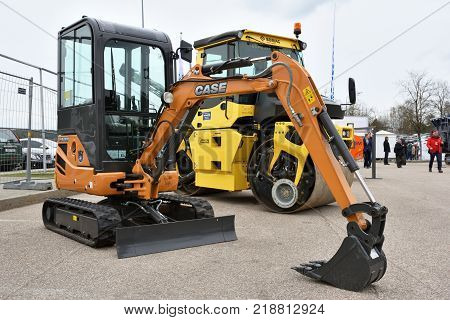 VILNIUS LITHUANIA - APRIL 27: Case mini excavator on April 27 2017 in Vilnius Lithuania. Case Construction Equipment is a brand of construction equipment from CNH Industrial