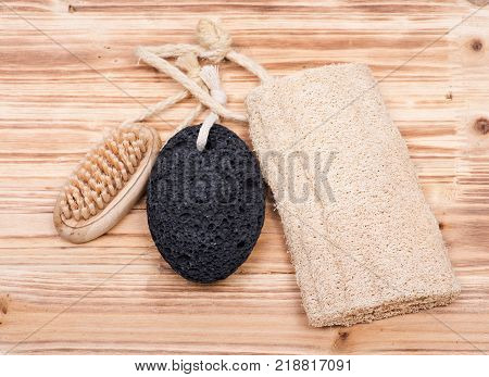 Natural bristle hand and nail wooden brush, volcanic pumice stone and loofah sponge on wooden vintage background