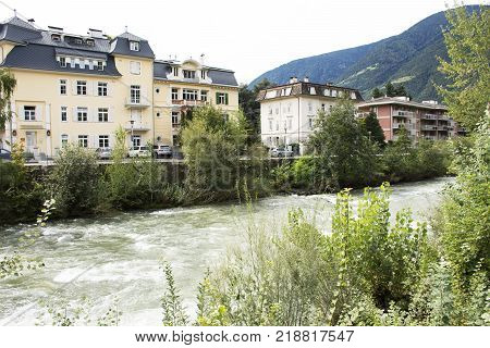 View Cityscape And Landscape With Classical Building At Riverside Of Of Passer River At Meran Or Mer