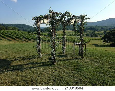 wedding altar made of flowers and wood in the mountains