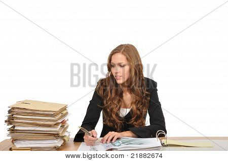 Young Woman Looks At Pile Of Documents