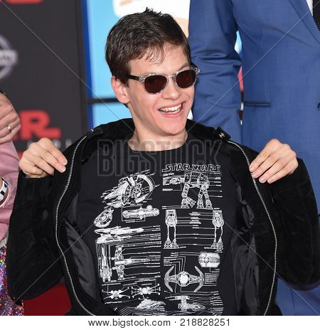 LOS ANGELES - DEC 09:  Micah Fowler arrives for the 'Star Wars: The Last Jedi' World Premiere on December 09, 2017 in Los Angeles, CA