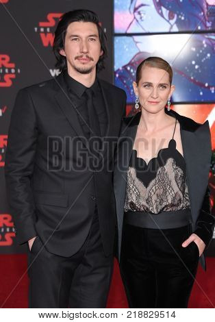 LOS ANGELES - DEC 09:  Adam Driver and Joanne Tucker arrives for the 'Star Wars: The Last Jedi' World Premiere on December 09, 2017 in Los Angeles, CA