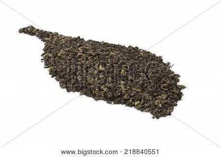 Green tea on isolation. Heap of dry leaves of green tea in leaf form on a white background. Dried tea close up. Placer of green tea. Anti oxidant caffeine.