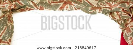 Banner Decorative draping frame of the textile. Women's scarf red figure the British flag. White background top view
