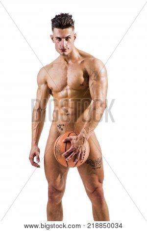 Totally naked male bodybuilder hiding genitals with basketball ball, looking at camera smiling, isolated on white background.