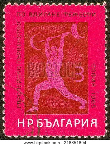 UKRAINE - circa 2017: A postage stamp printed in Bulgaria shows European Championships weight lifting Series Championships circa 1965