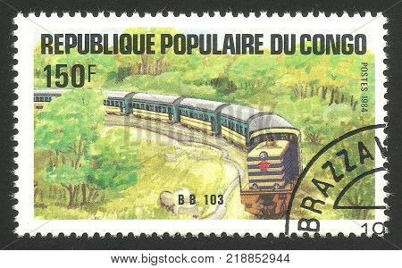 Congo - CIRCA 1984: Stamp printed by Congo Multicolor memorable edition offset printing on the topic of Railway and Trains shows Locomotive Bb 103