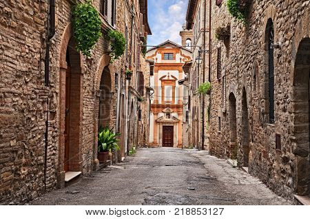 Bevagna, Perugia, Umbria, Italy: ancient church at the end of a narrow alley in the medieval town