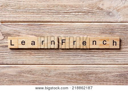 learn french word written on wood block. learn french text on table concept.